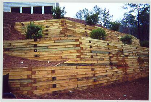 site evaluation and design of concrete timber and segmental block retaining walls